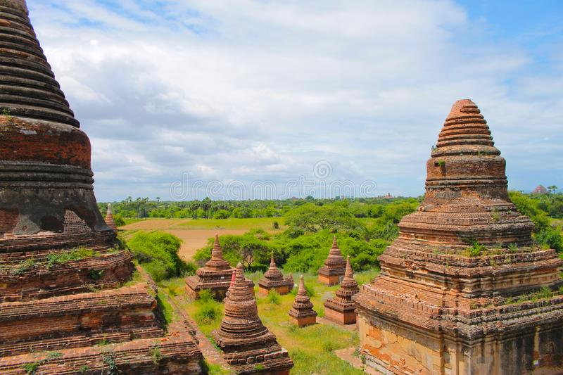 Bagan temples in the middle of the forest with a beautiful blue sky, Bagan, Myanmar Burma. royalty free stock images