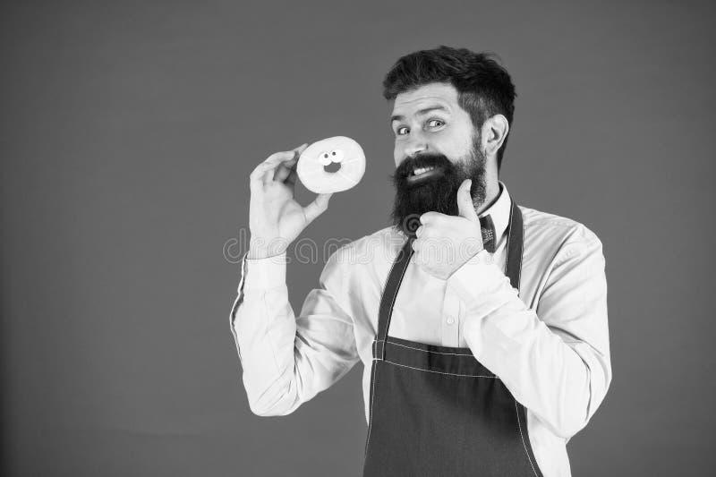 Bagareh?llmunk Rolig hipster s?t munk Kockman i kaf? Banta och sund mat Munken bantar kalori feel arkivfoto