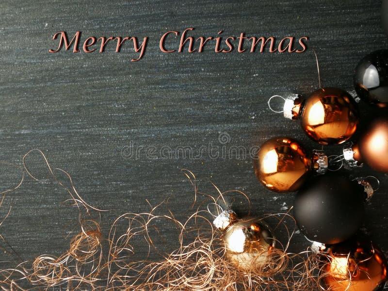 Bagattelle della carta di Buon Natale nere e di rame immagini stock