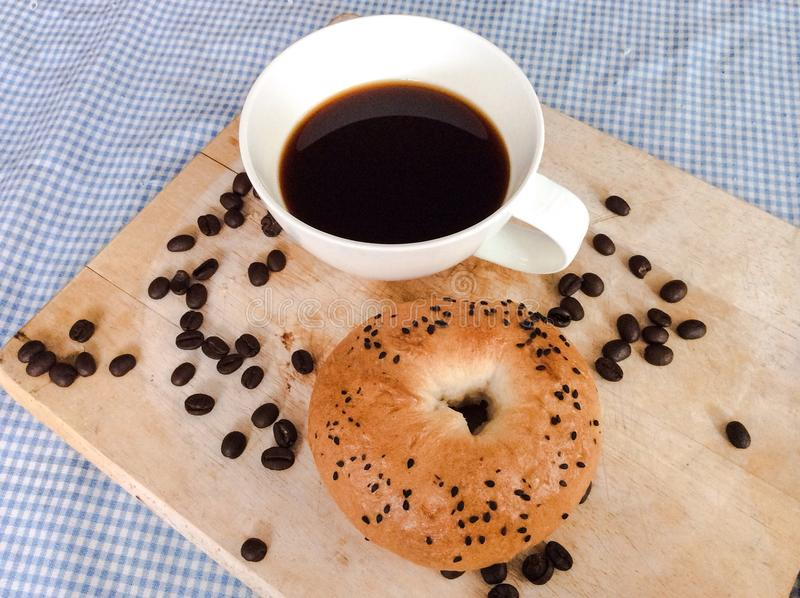 Bagel with coffee stock photos