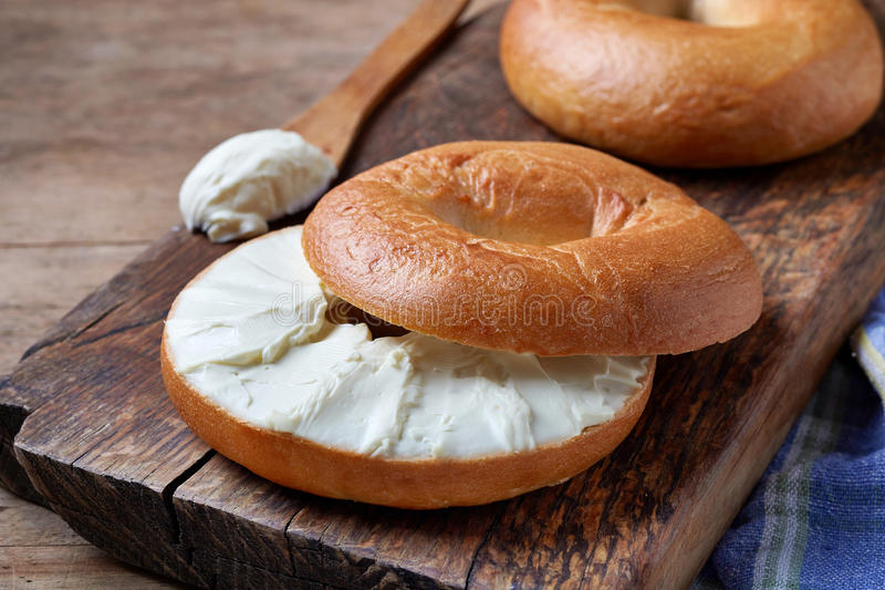 Bagel with cream cheese stock photo
