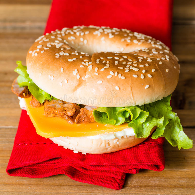 Bagel with fresh cheese and fresh lettuce stock images