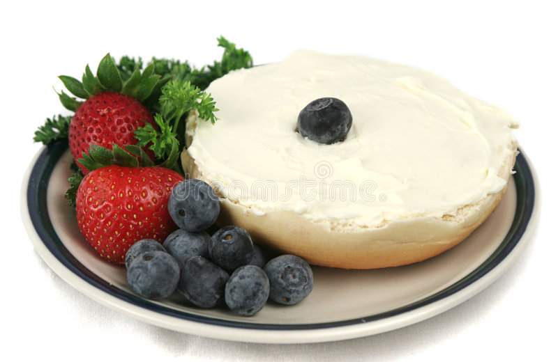 Download Bagel & Fruit Isolated stock photo. Image of cream, blue - 165880