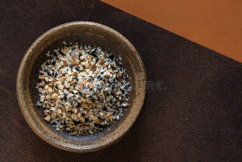Bagel Seasoning in een Bowl stock afbeeldingen
