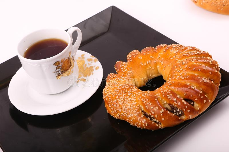 Bagel with tea. On black Tray stock images