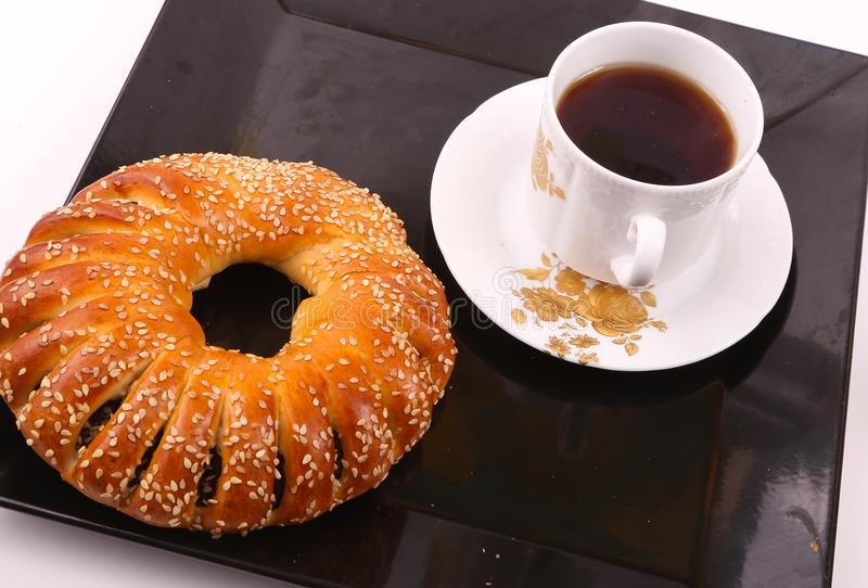 Bagel with tea. On white plate royalty free stock photo
