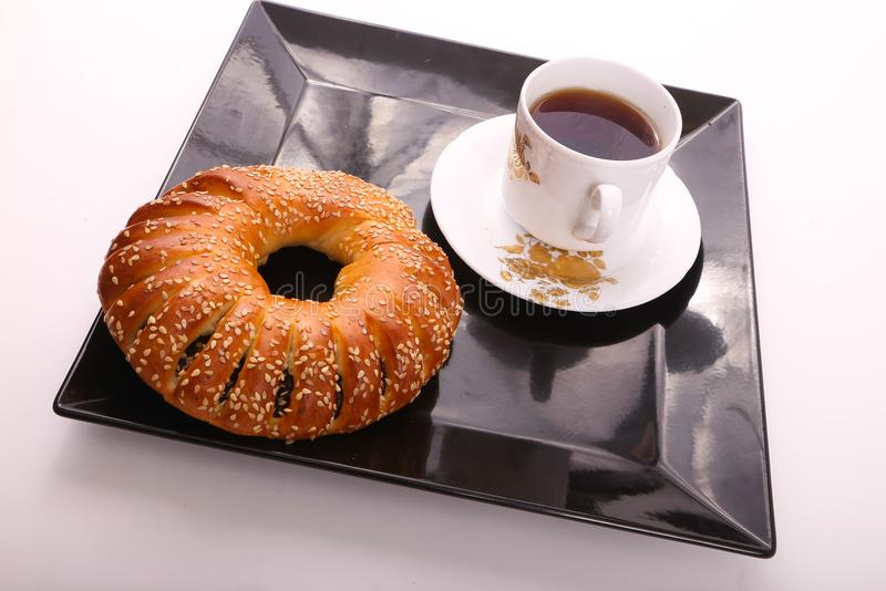Bagel with tea. On white plate royalty free stock image