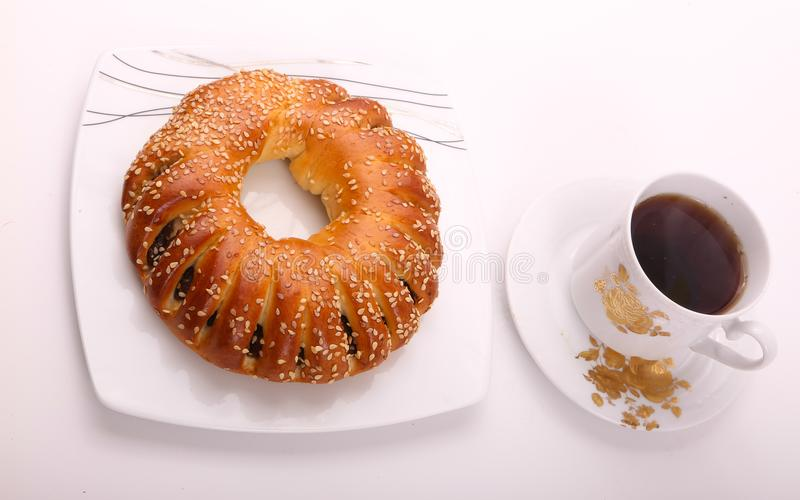 Bagel with tea. On white plate on white background stock image