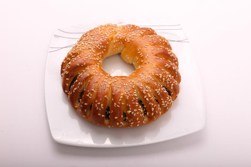 Bagel. On white plate on white background royalty free stock images
