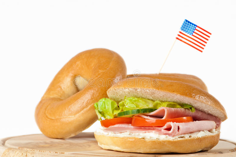 Bagels With American Flag. New York bagels with American flag on white background royalty free stock photo