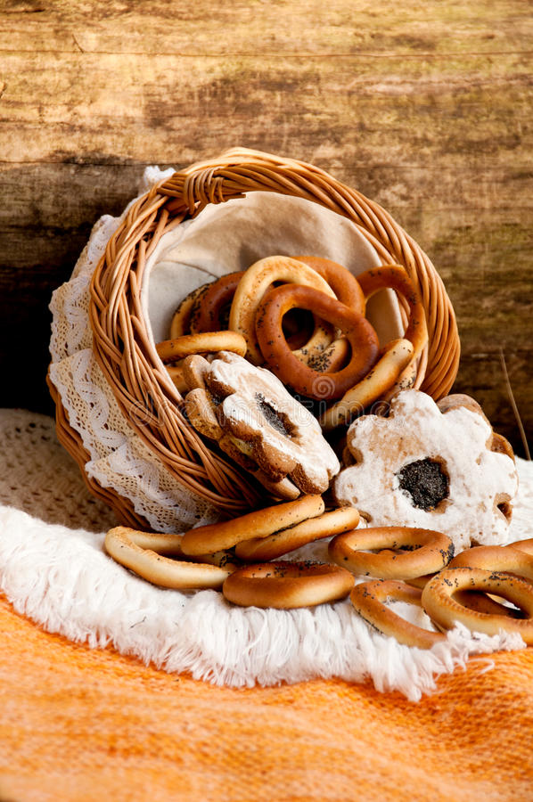 Free Bagels And Cookies Scattered From Wicker Basket Stock Images - 29402014