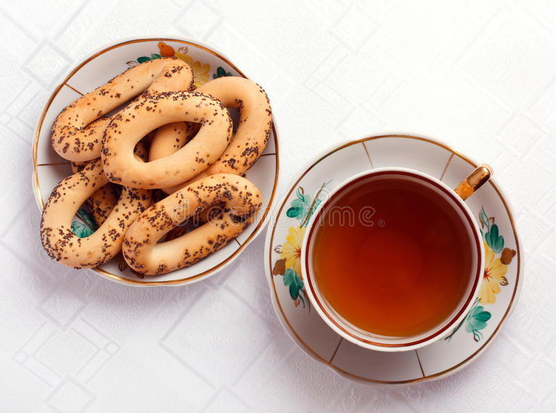 Download Bagels And A Cup Of Tea On The Tablecloth Royalty Free Stock Photo - Image: 22451635