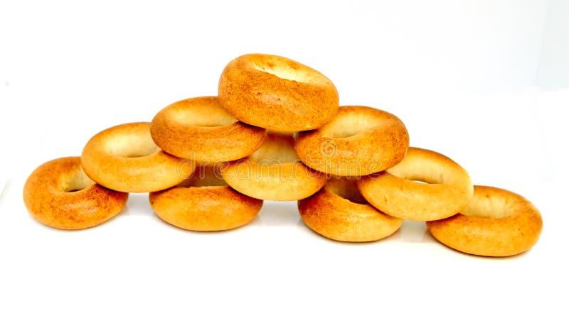 Bagels de couleur d'or d'isolement images stock