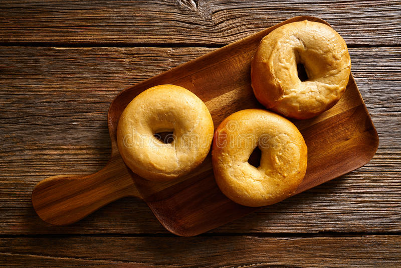 Bagels in a wooden board stock images
