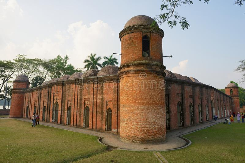 People visit Shat Gombuj Mosque in Bagerhat, Bangladesh. royalty free stock photography
