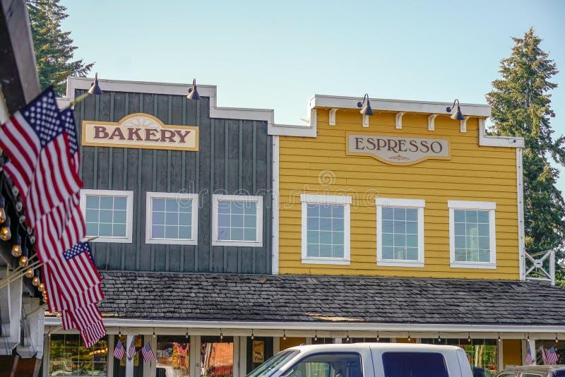 Bageri- och espressokaféer med amerikanska flaggan royaltyfria bilder