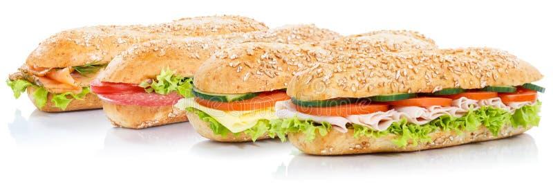Bagettsubsmörgåsar med laxen för salamiskinkaost fiskar helt arkivfoton