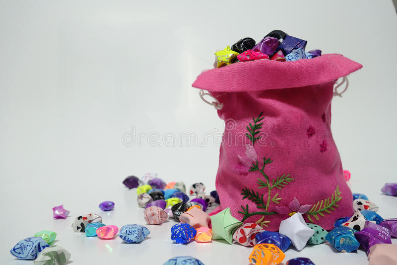 A bagful of lucky stars. A bag filled lucky stars, bringing joy and well wishes royalty free stock photo