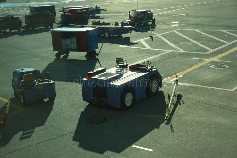 Baggage and airport vehicles at Southwest Airline gate. Airport and baggage vehicles awaiting flight at Southwest gate in Portland International Airport royalty free stock images