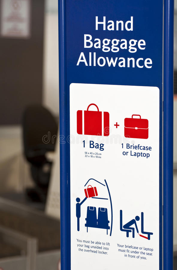 Baggage allowance. Hand baggage allowance sign at airport check in point royalty free stock image