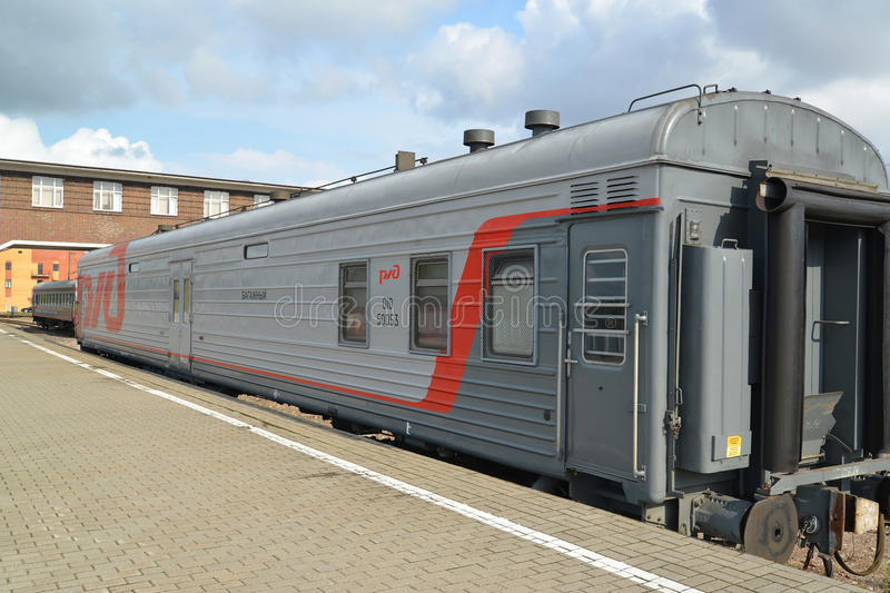 The baggage car costs at the desert platform of the station, Russia.  stock photography