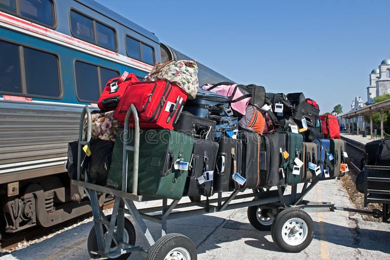 Baggage cart at train station stock photography