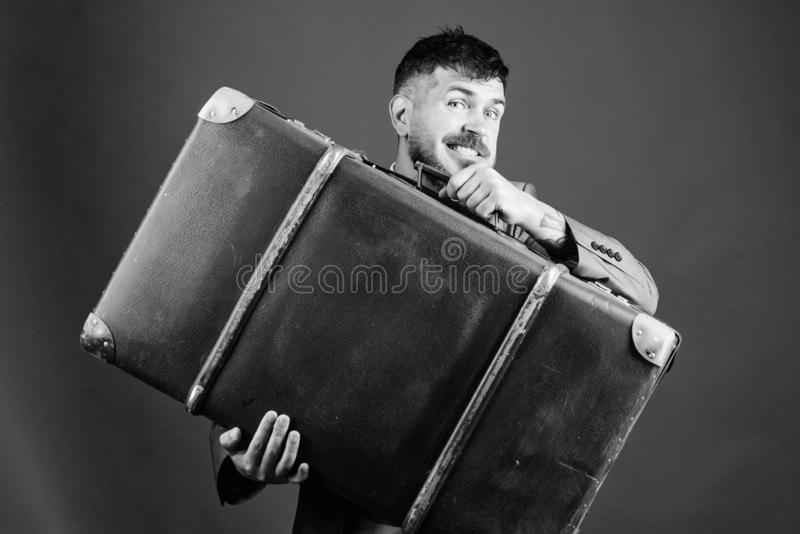 Baggage insurance. Man well groomed bearded hipster with big suitcase. Take all your things with you. Heavy suitcase stock photography