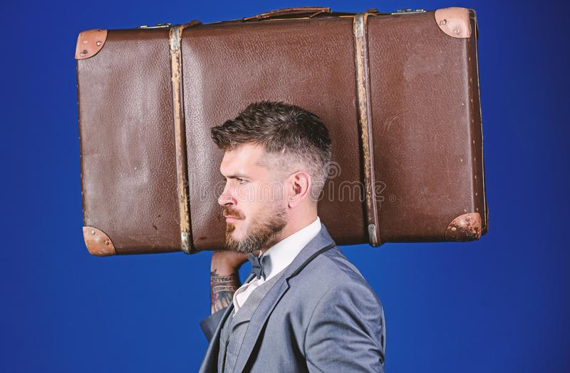 Baggage insurance. Travel and baggage concept. Man well groomed bearded hipster with big suitcase. Take all your things royalty free stock photo