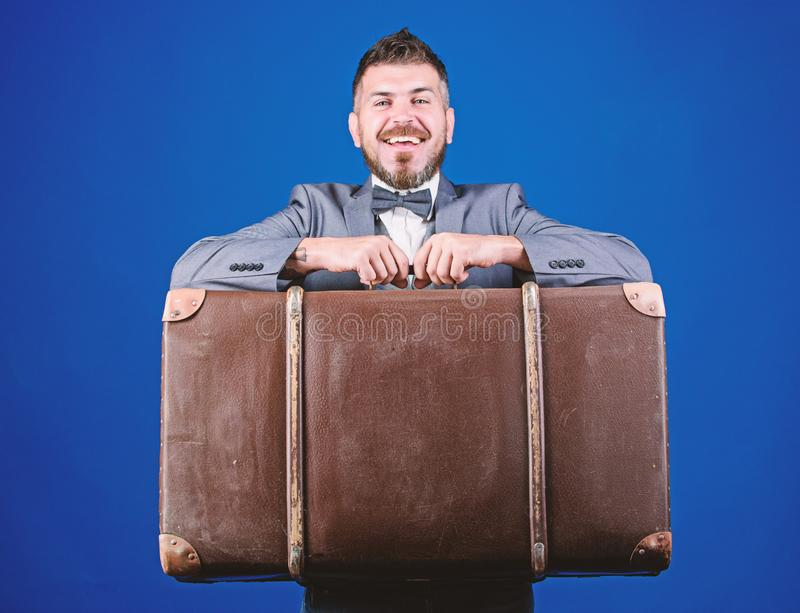 Baggage insurance. Travel and baggage concept. Hipster traveler with baggage. Man well groomed bearded hipster with big. Suitcase. Take all your things with you royalty free stock images