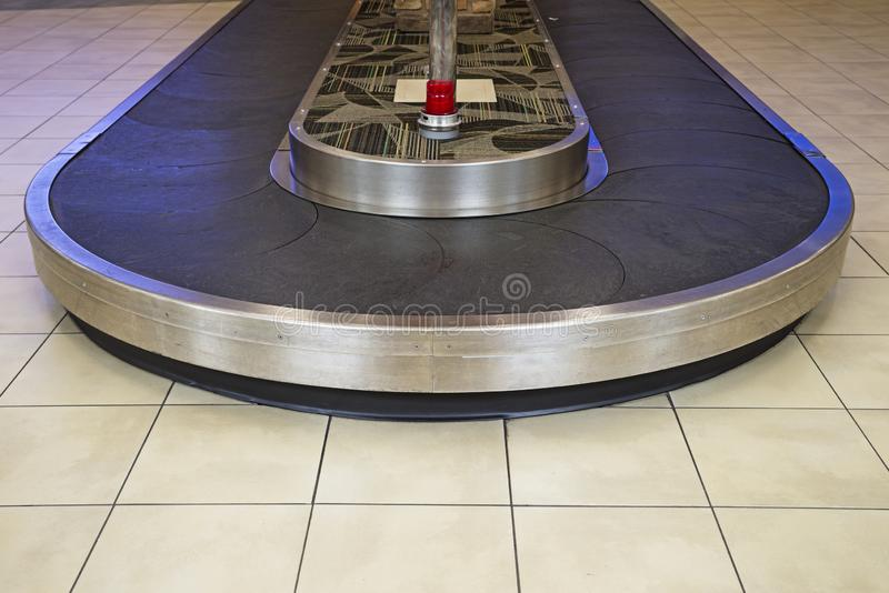 Baggage Reclamation Area. Airport baggage reclamation area conveyor with no luggage royalty free stock photography