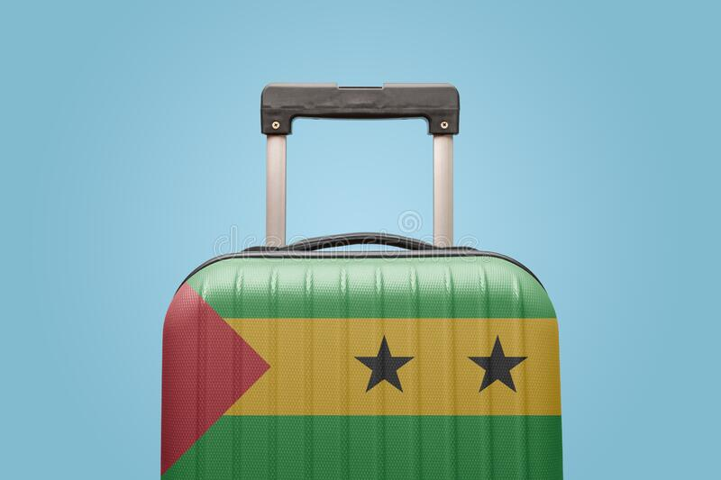 Baggage with Sao Tome and Principe flag print tourism and vacation concept. Suitcase with São Tomé and Príncipe flag design travel Africa concept royalty free stock photography