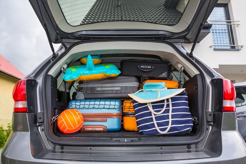 Baggages in the car trunk packed and ready to go for holidays stock photos