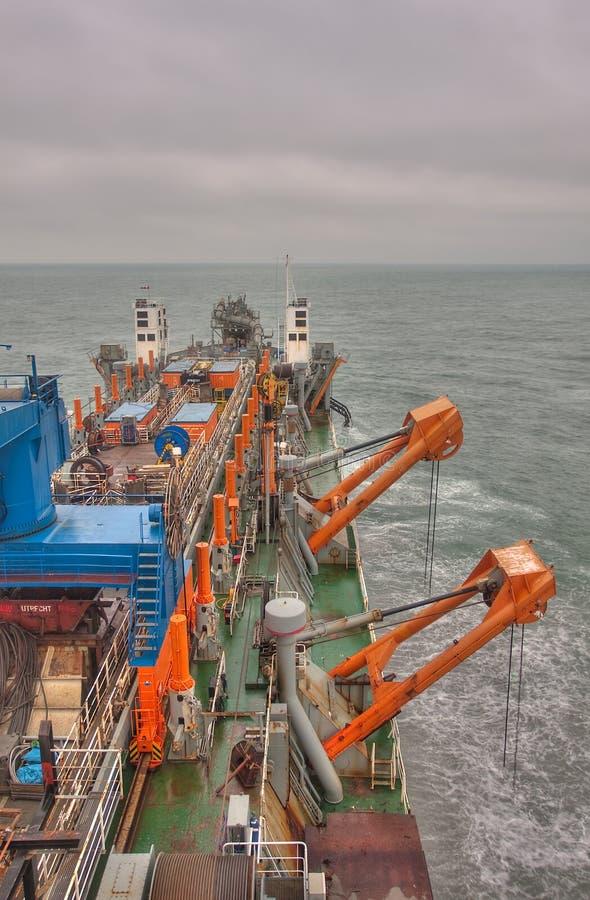 Baggermachine op zee royalty-vrije stock afbeeldingen