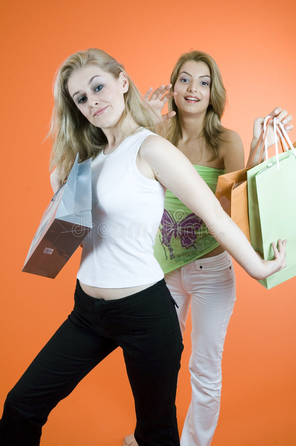Bagging a Bargain. Woman defending her prized purchase from another shopper royalty free stock images