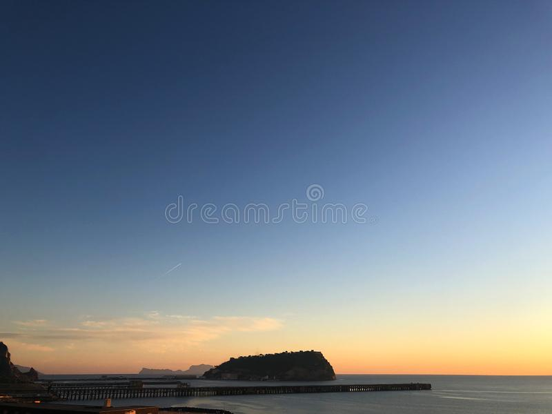 Bagnoli sunset with Nisida and Capri royalty free stock image