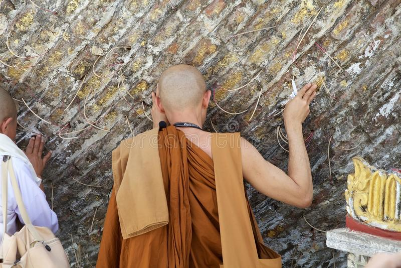 Bago. Buddhist monk in traditional robes is praying at the Shwemawdaw Paya, Bago, Myanmar. Shwemawdaw Paya is a stupa located in Bago, Myanmar. It is often stock photography