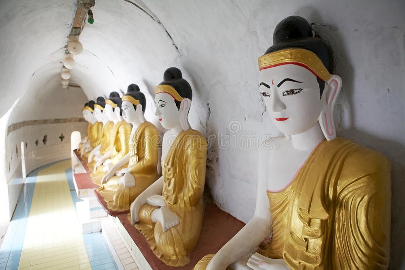 Bago. Shwegugale pagoda, Bago, Myanmar. Shwegugale pagoda was built in 1494 and it is a circular tunnel with 64 Buddha statues in the same posture placed inside royalty free stock image
