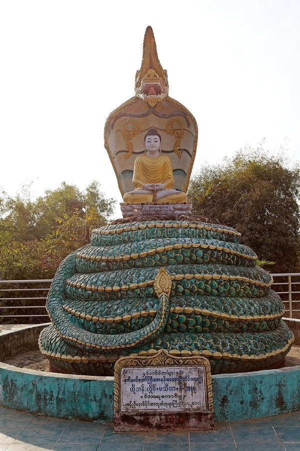 Bago. Statue of Buddha near the Kyaik Pun pagoda, Bago, Myanmar. Kyaik Pun pagoda was built in 7th Century and it is the home for the four seated Buddha shrine royalty free stock photography