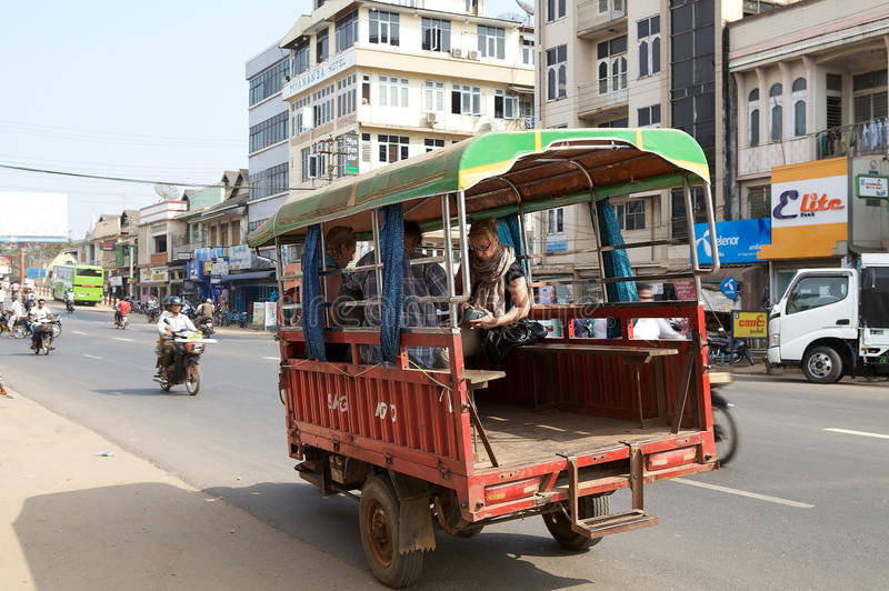 Bago. Tourists are using a traditional local share taxi in Bago, Myanmar. Bago is a city and capital of Bagon Region. It is located 80 km north-east of Yangon royalty free stock photography