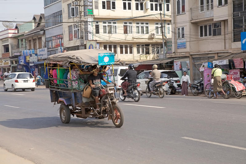 Bago. Traditional local share taxi full of people along the street in Bago, Myanmar. Bago is a city and capital of Bagon Region. It is located 80 km north-east stock photos