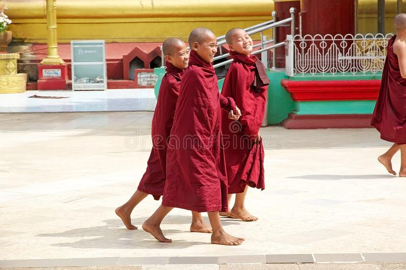 Bago. Young Bhuddist monks in traditional robes are walking in the Shwemawdaw Paya site, Bago, Myanmar. Shwemawdaw Paya is a stupa located in Bago, Myanmar. It royalty free stock images