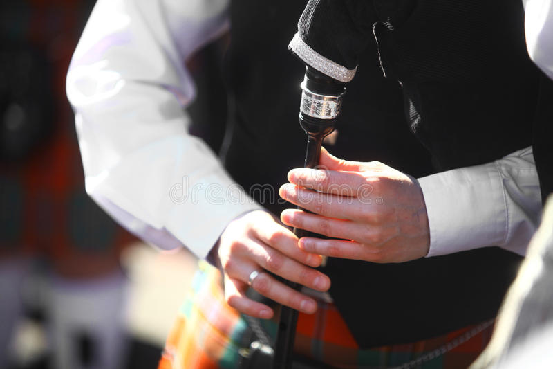 Bagpipe. Color shot of a man playing a traditional bagpipe stock photography