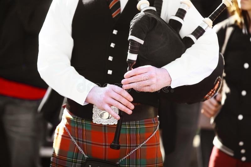 Bagpipe. Color shot of a person holding a traditional bagpipe royalty free stock image