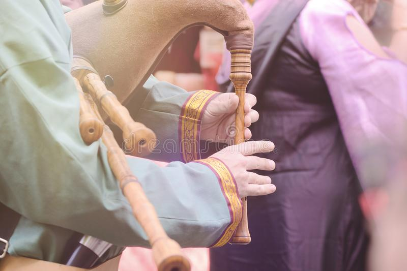 Bagpipe instrument in a traditional Medieval festival. Empty copy space for Editor`s text royalty free stock photo