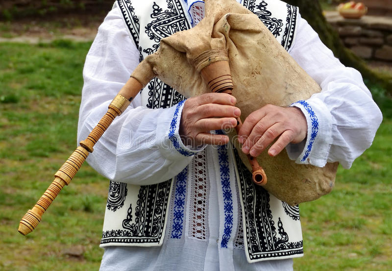 Bagpipe. Person holding a traditional bagpipe stock images