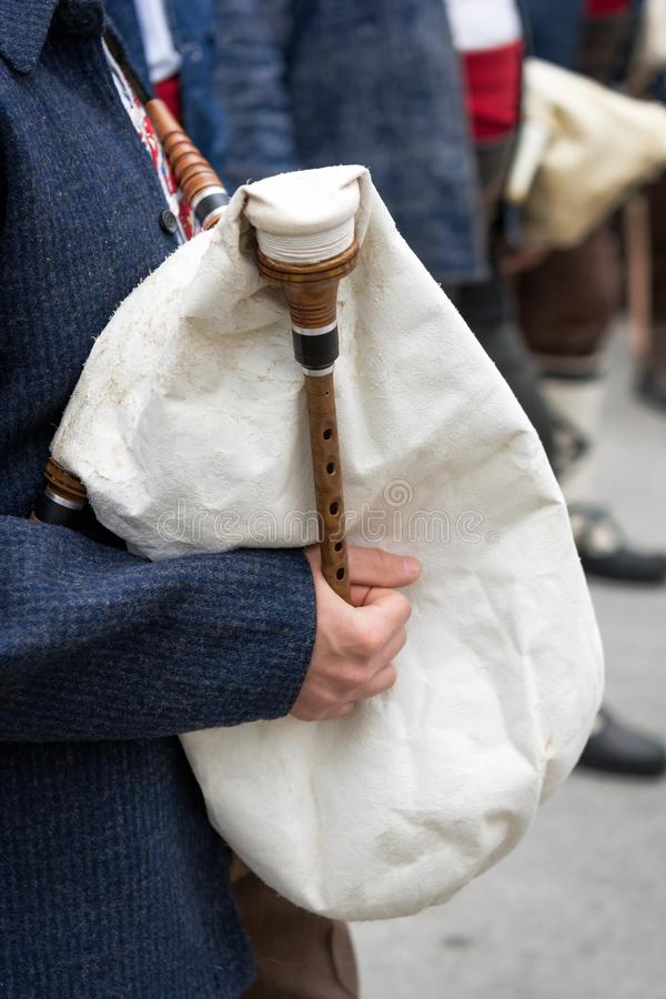 Bagpipe player. Close up of a man playing the bagpipe stock photos