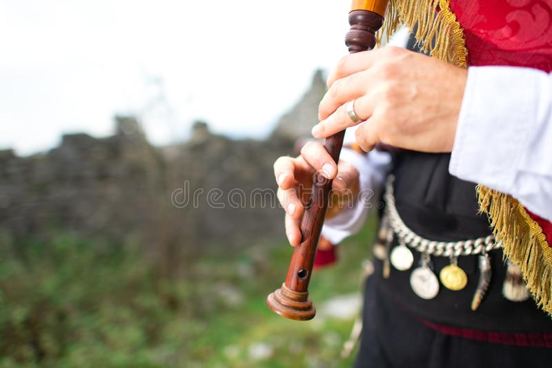Bagpipe player detail. With traditional dress.  stock photos