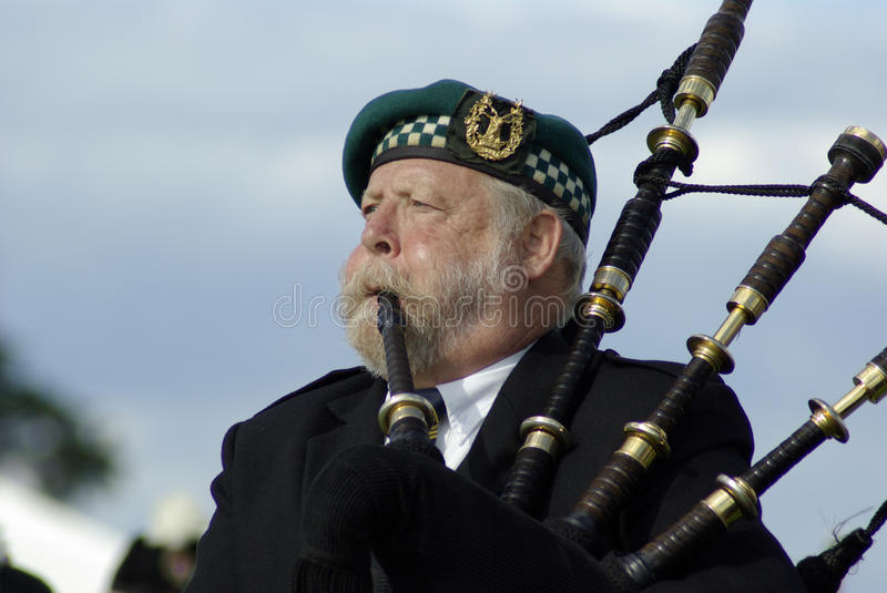 Bagpipe player in Edinburgh. Old bagpipe player at the Gathering 2009, in Edinburgh, scotland stock images