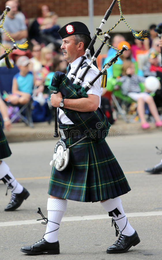Bagpipe Player in a Parade royalty free stock images