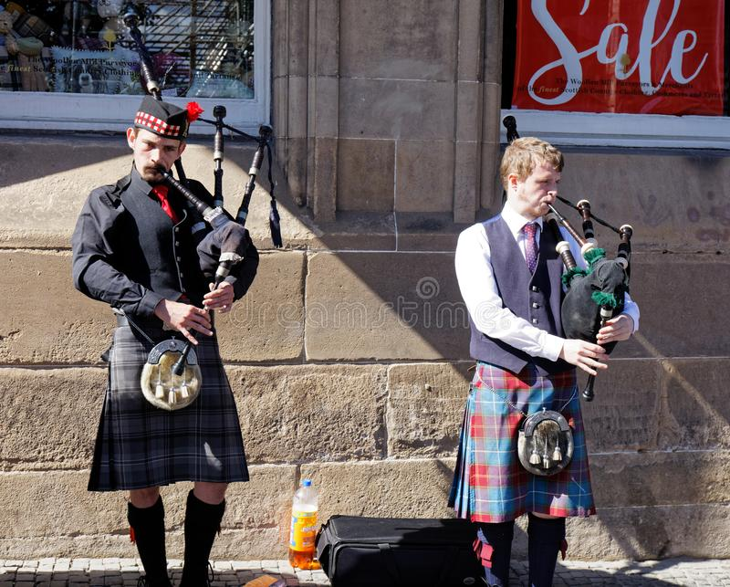 Bagpipe players in a street of Edinburgh - Scotland royalty free stock images